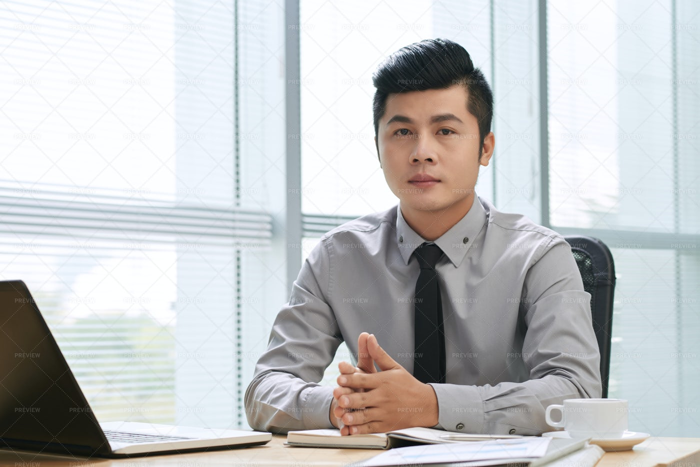 Handsome Businessman Looking At...: Stock Photos