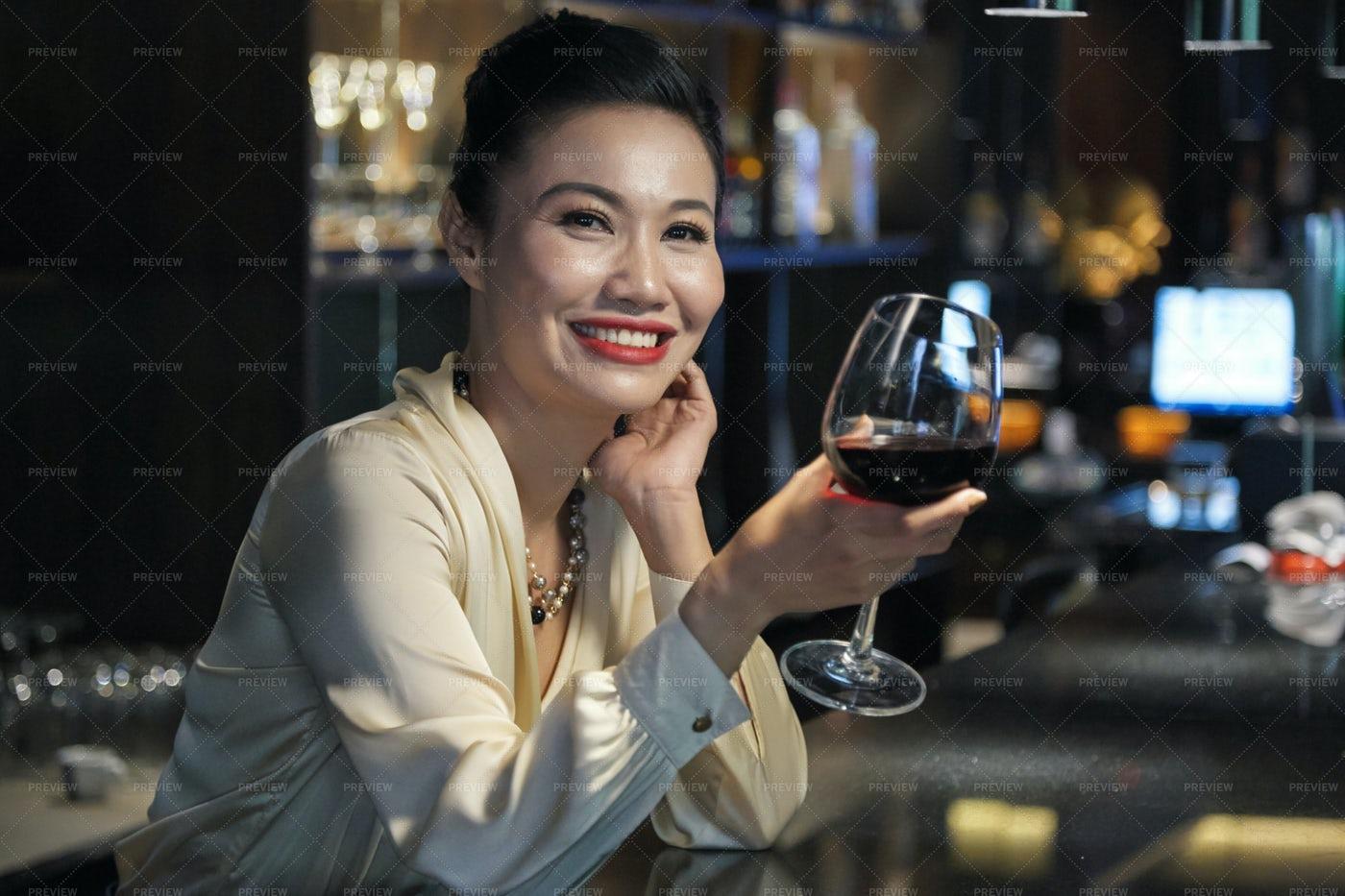 Smiling Elegant Asian Female With...: Stock Photos