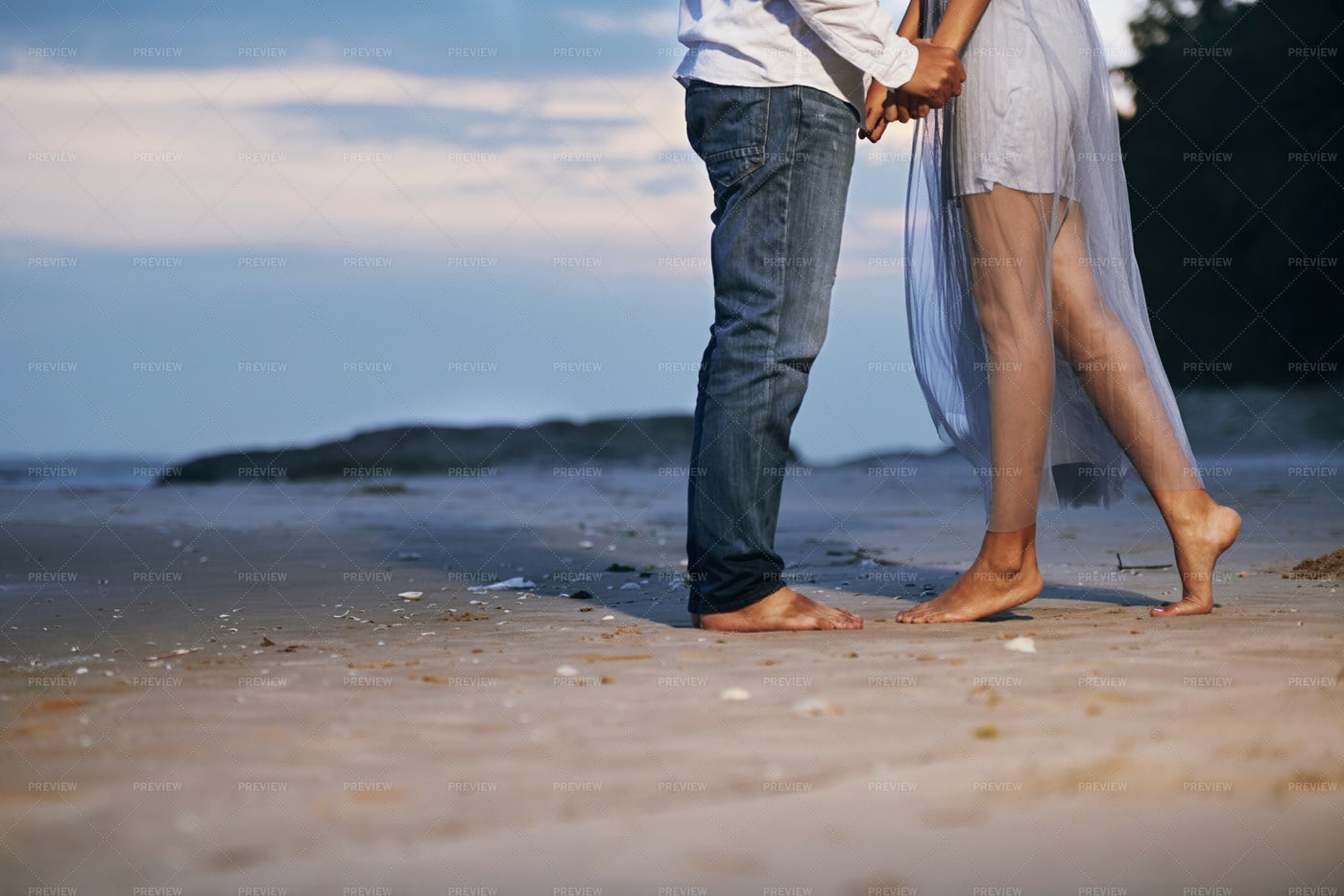 Couple In Love Standing On Beach: Stock Photos
