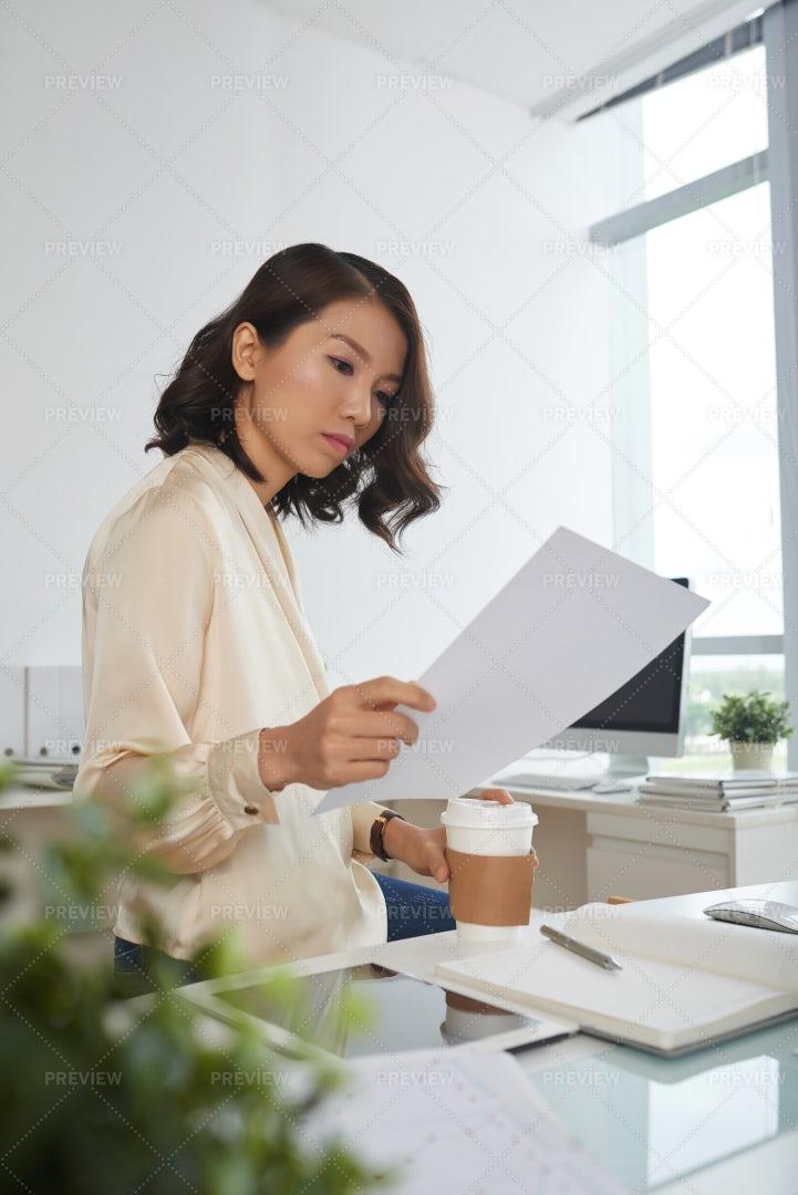 Serious Woman Reading Contract: Stock Photos