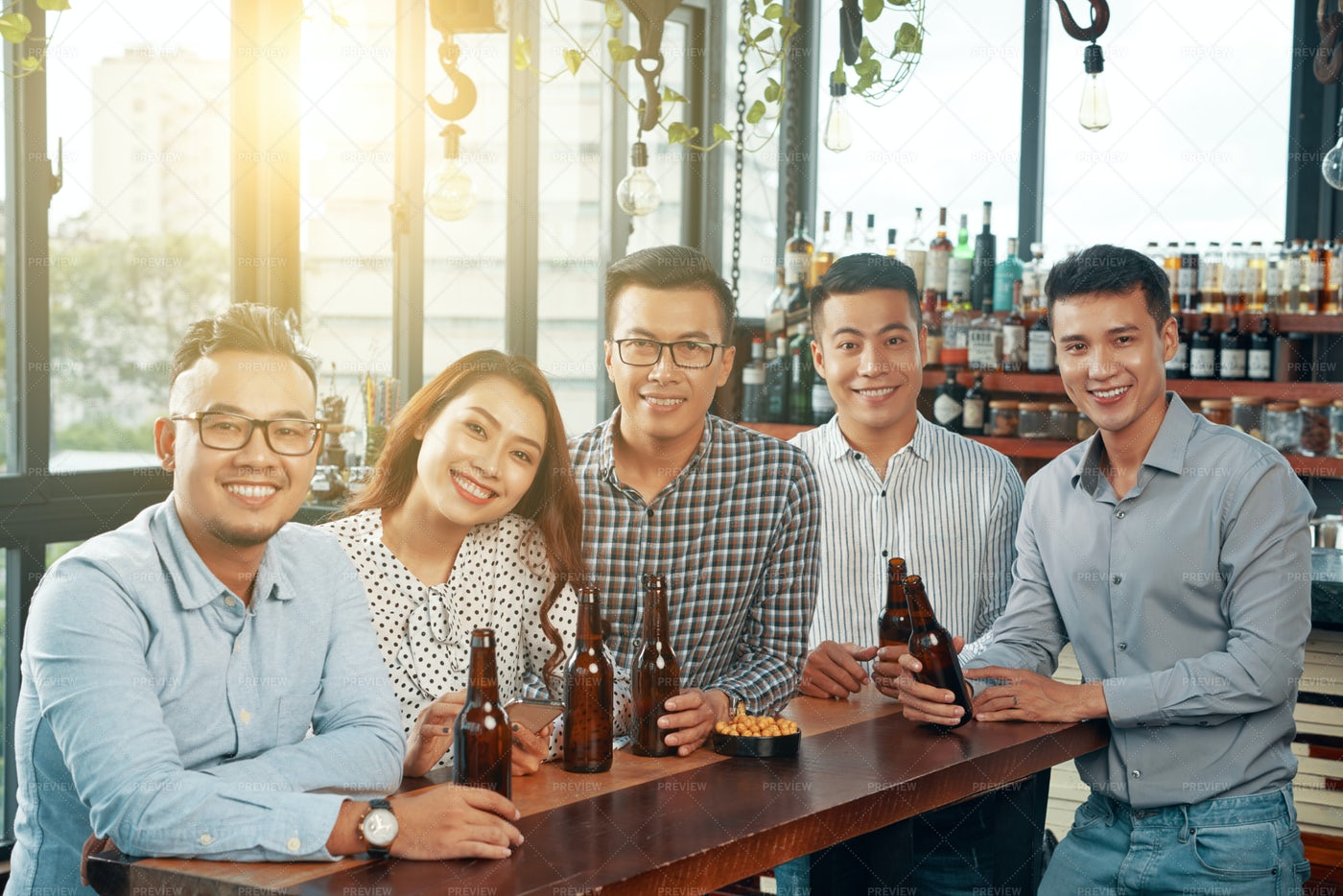 Cheerful Colleagues In Pub: Stock Photos