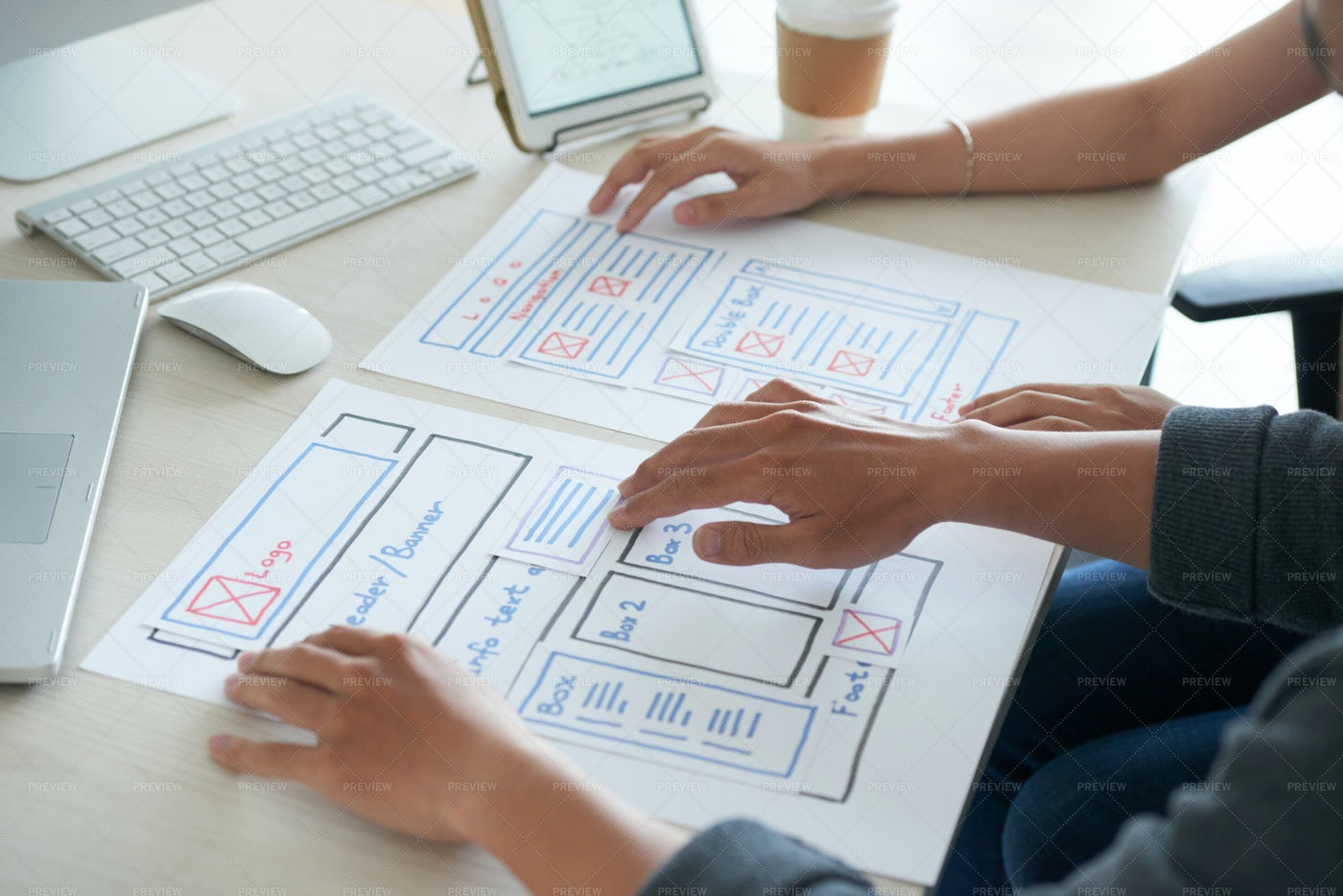 Programmers Studying Website Layout...: Stock Photos