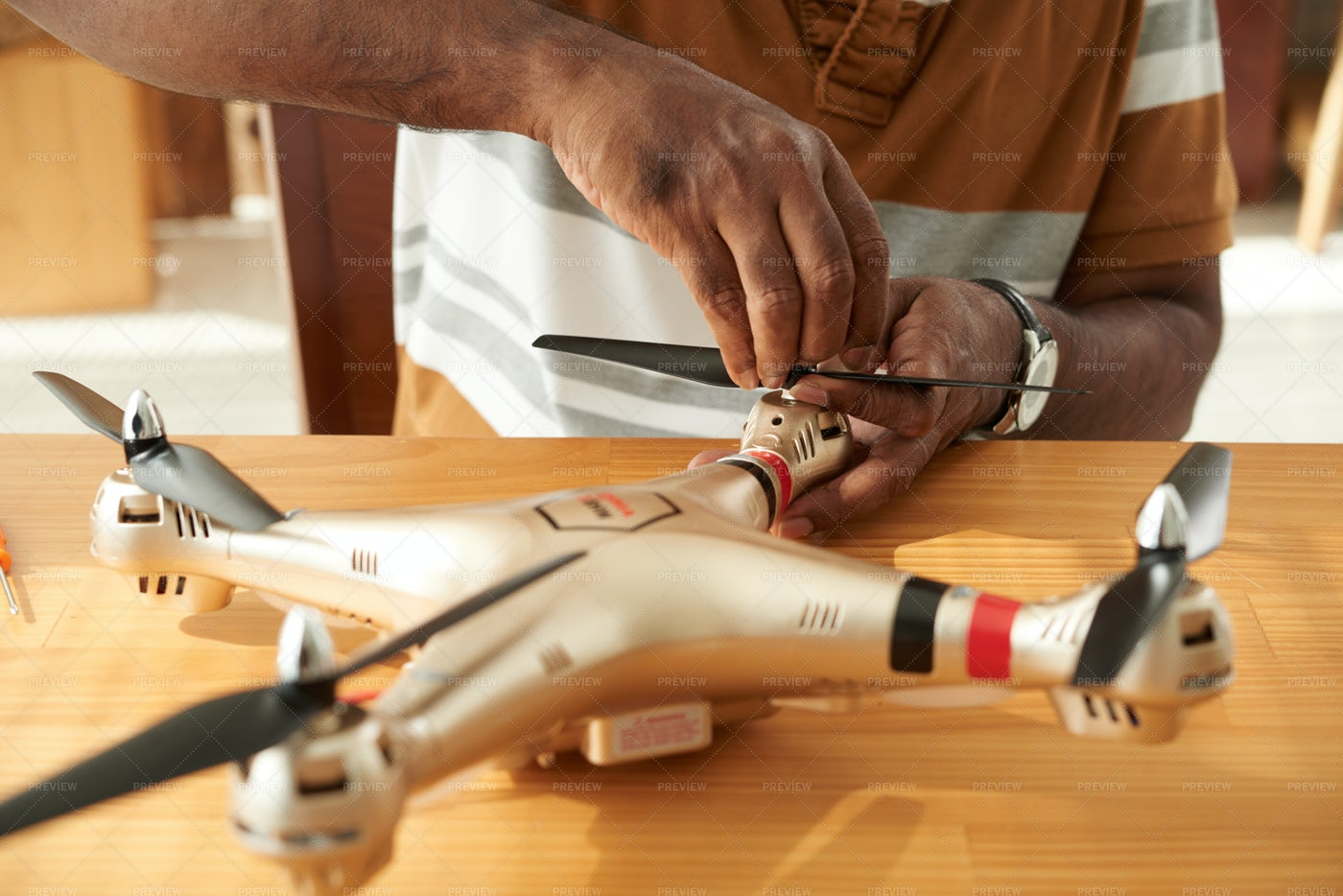 Man Fixing Drone Propeller: Stock Photos