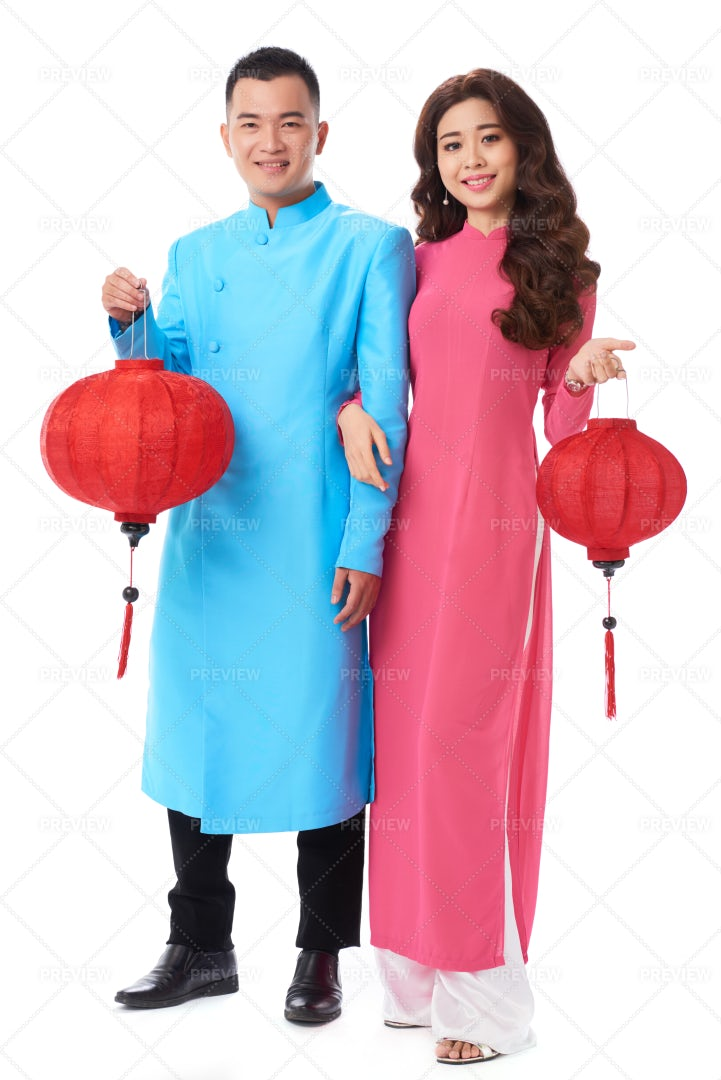 Couple With Tet Decorations: Stock Photos