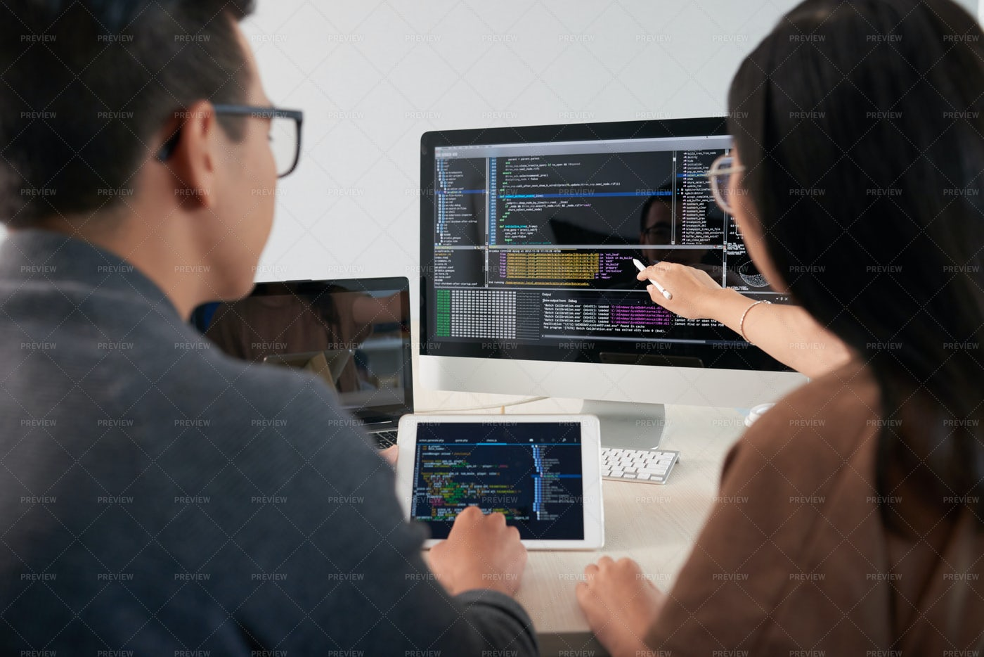 Programmers Looking At Source Code...: Stock Photos