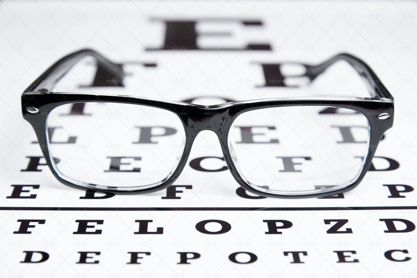 Glasses On Vision Test Chart: Stock Photos