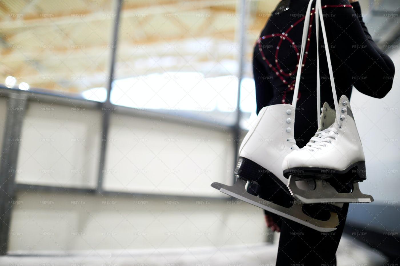 Girl Holding Figure Skates: Stock Photos