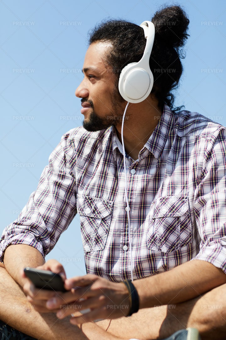 Contemporary Man Listening To Music...: Stock Photos