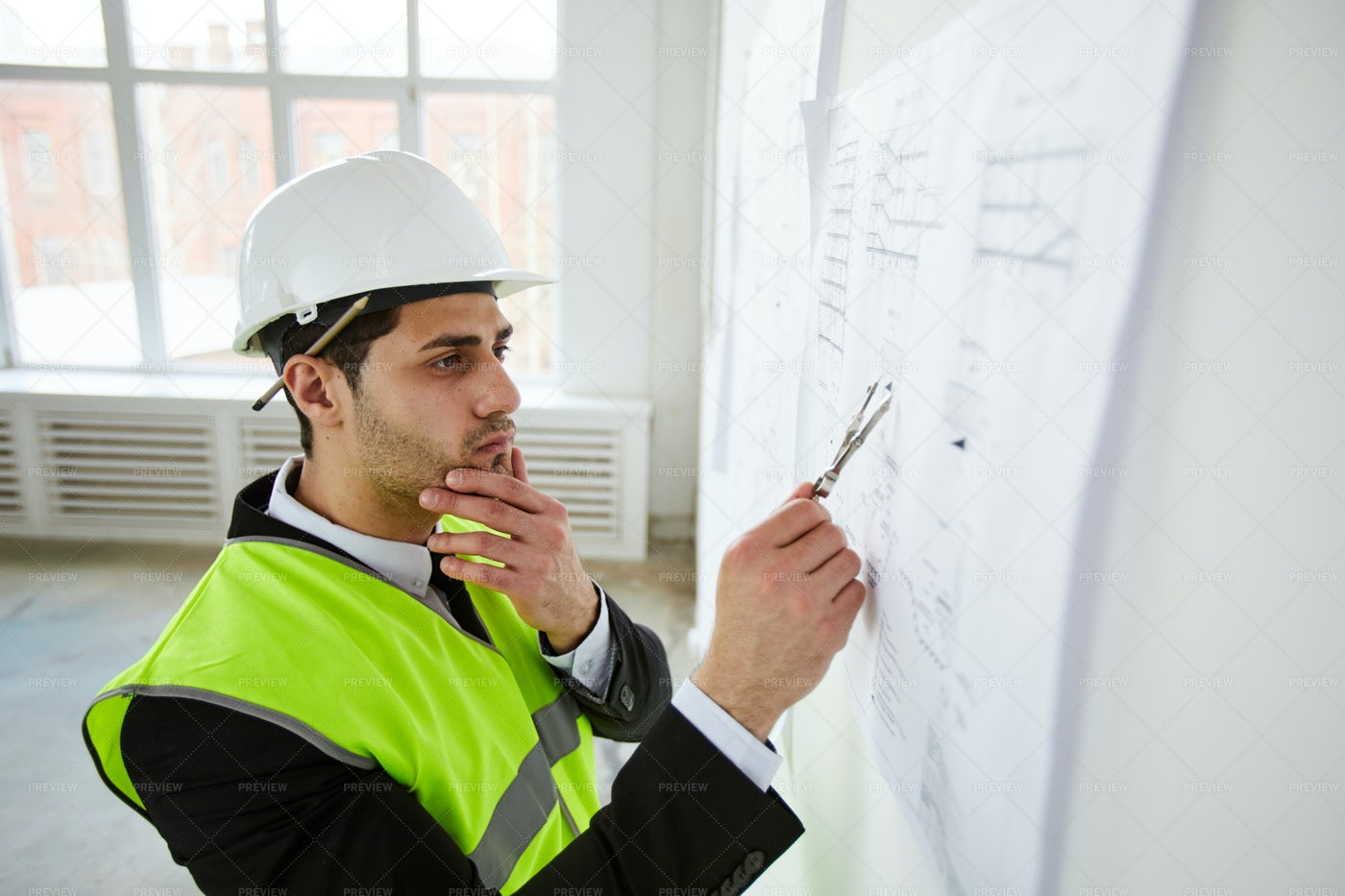 Engineer Thinking Over Plans: Stock Photos