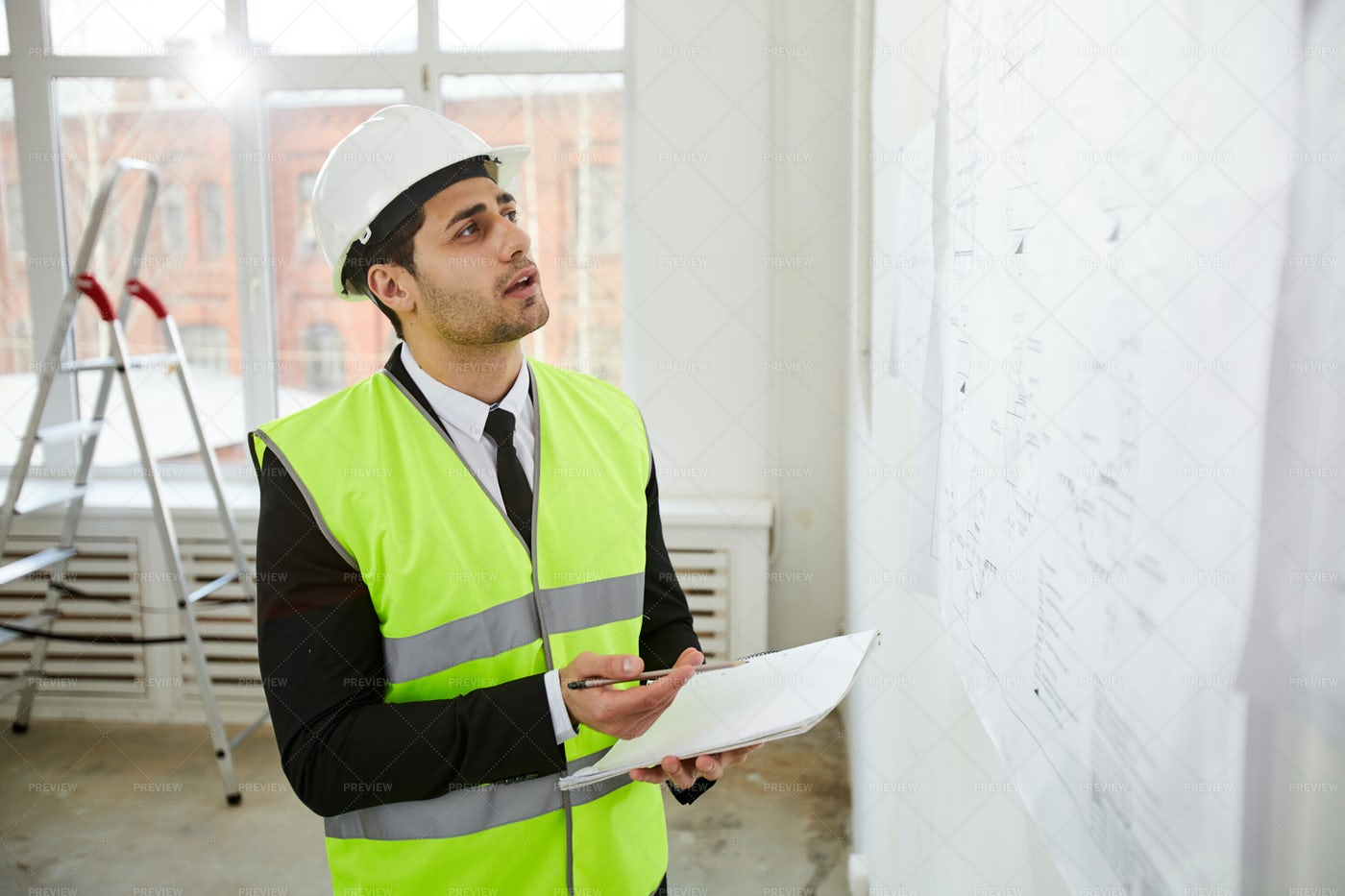 Middle-Eastern Engineer Inspecting...: Stock Photos