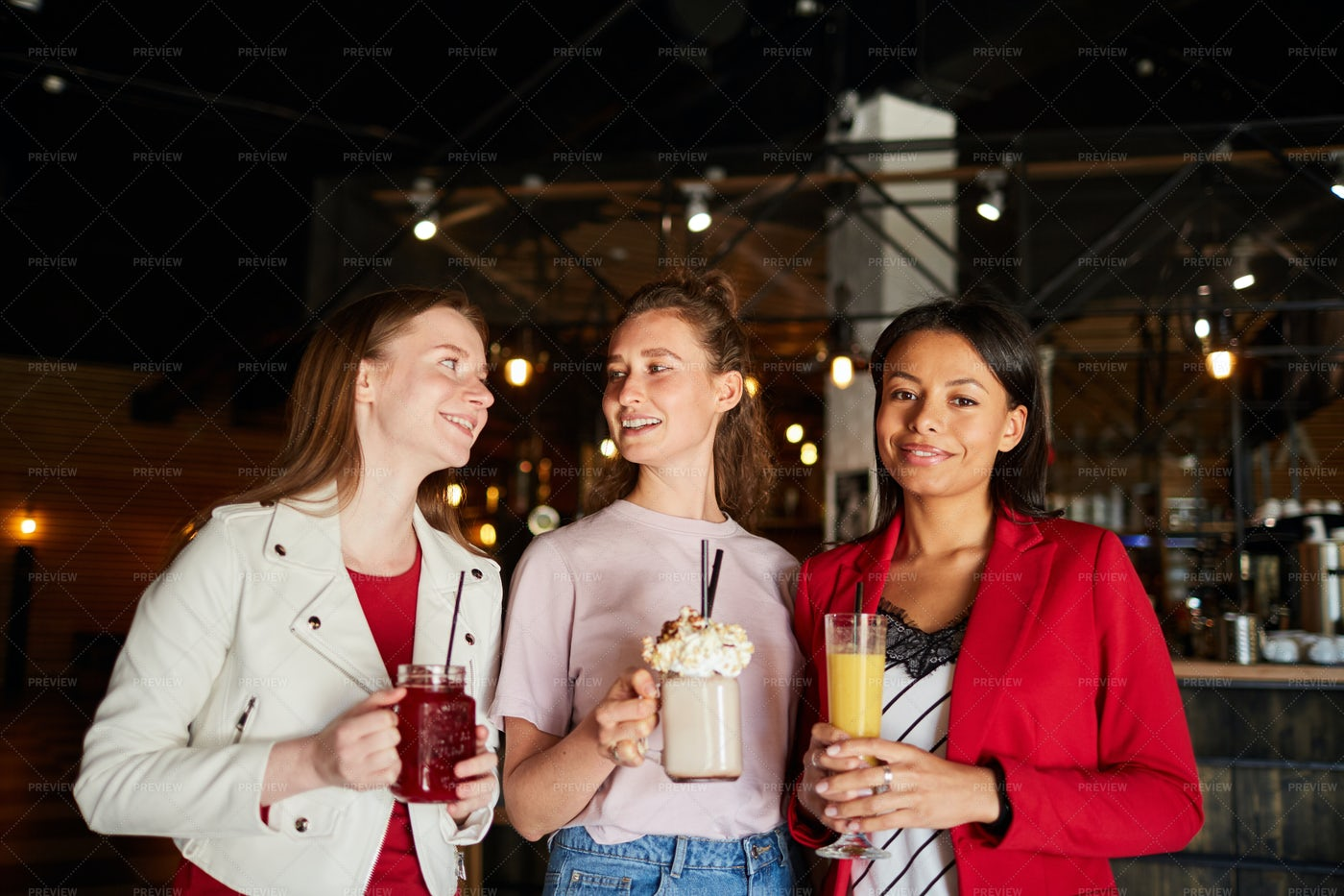 Smiling Women With Beverages: Stock Photos