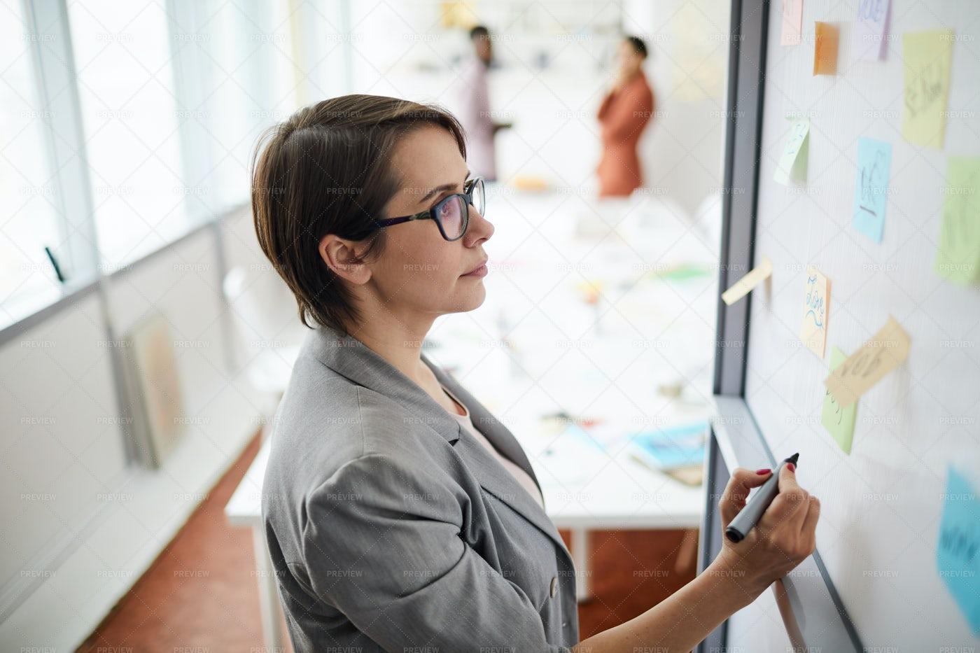 Businesswoman Writing On Whiteboard: Stock Photos