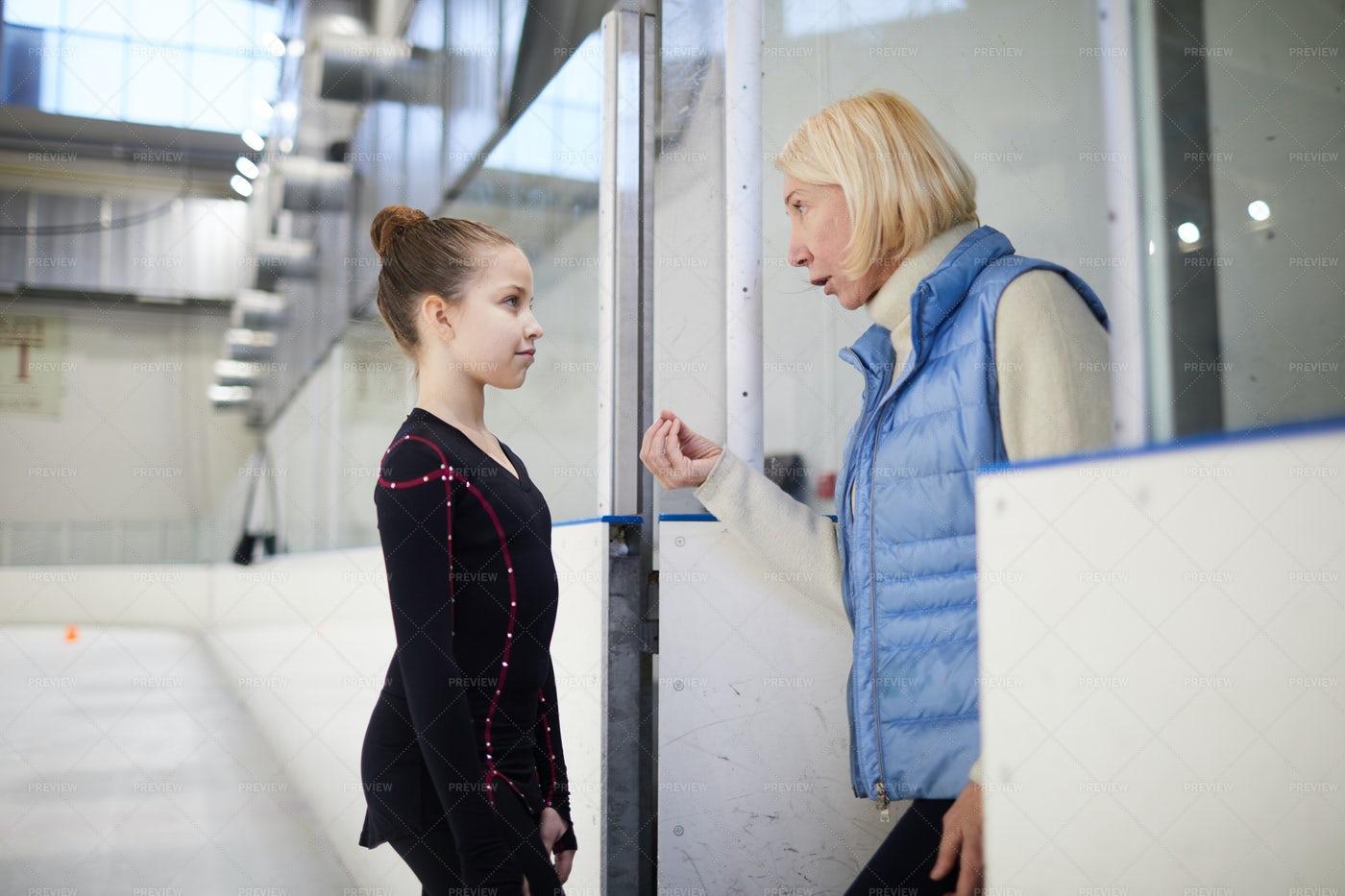Coach Motivating Little Girl: Stock Photos