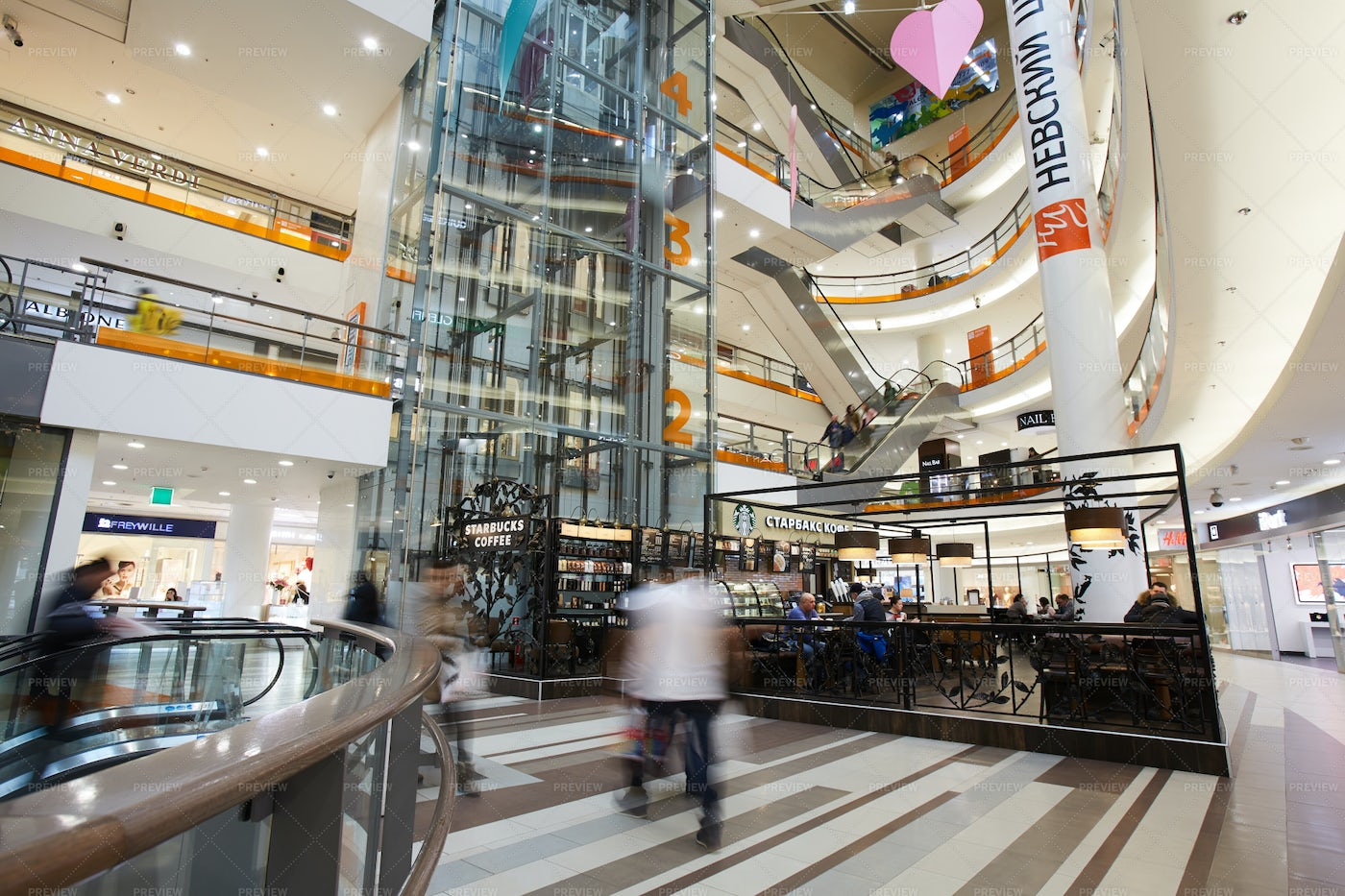 Modern Shopping Mall With Hurrying...: Stock Photos