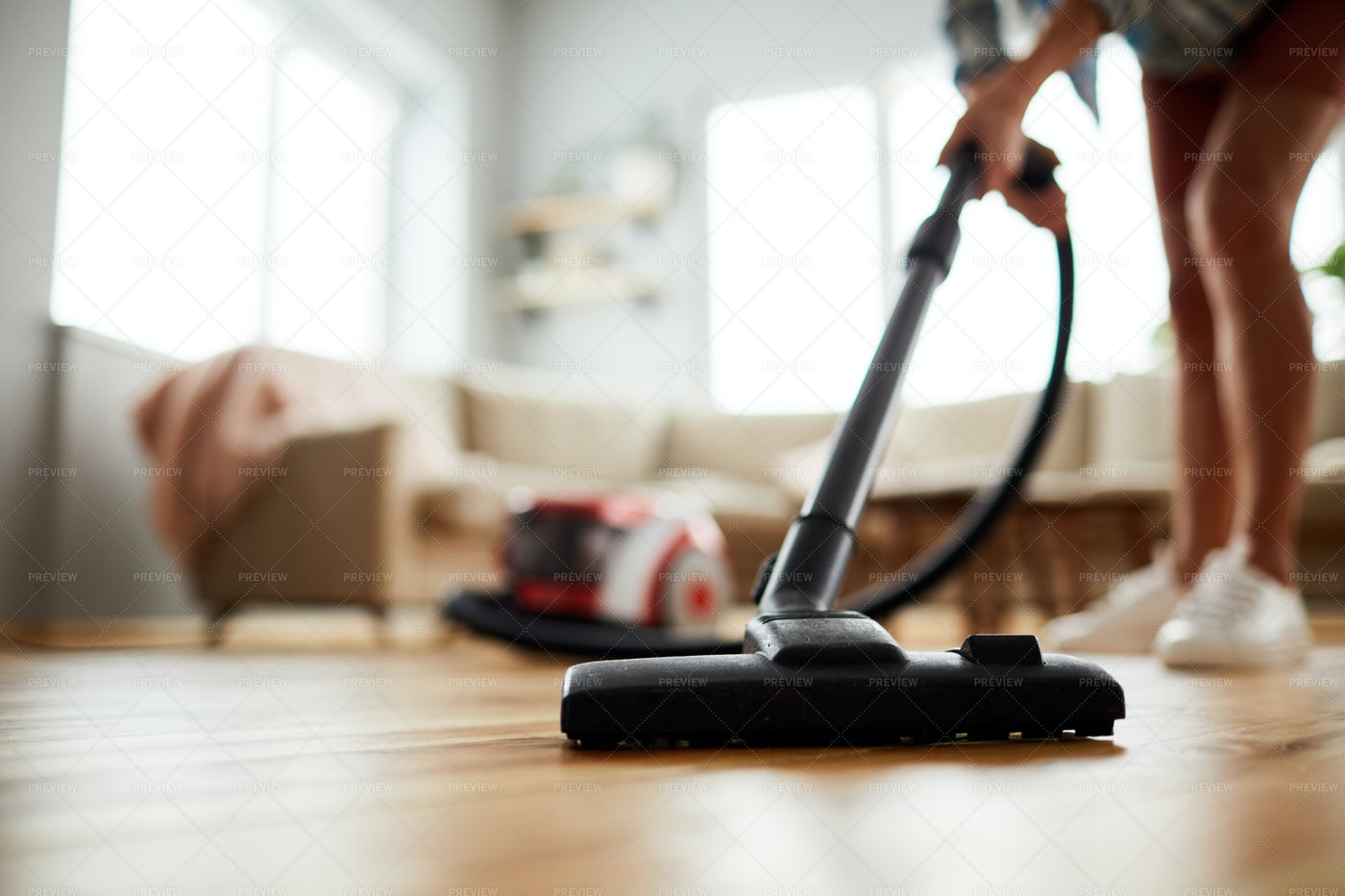 Vacuuming Floor At Home: Stock Photos