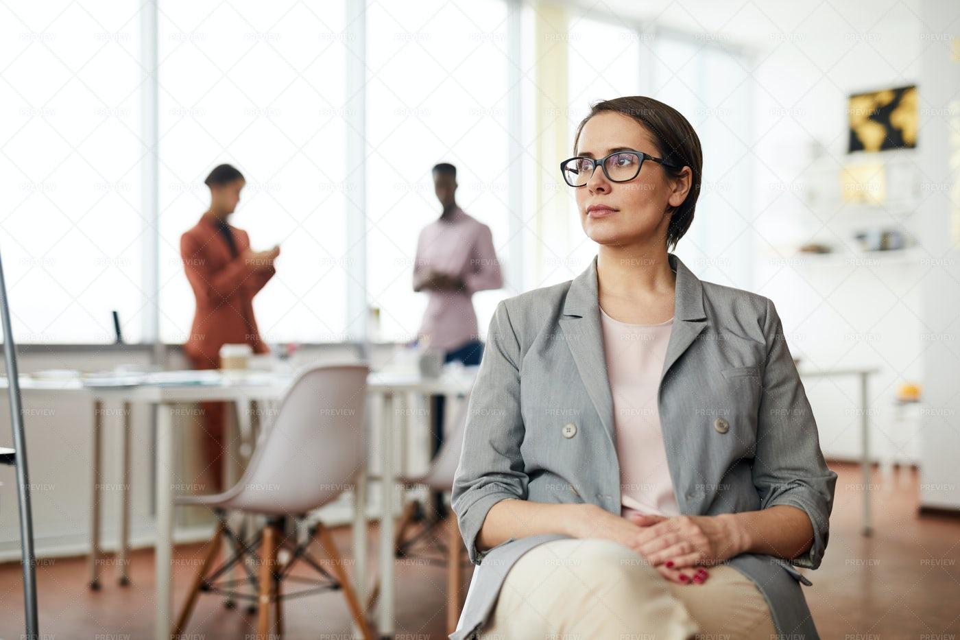 Pensive Businesswoman Sitting On...: Stock Photos