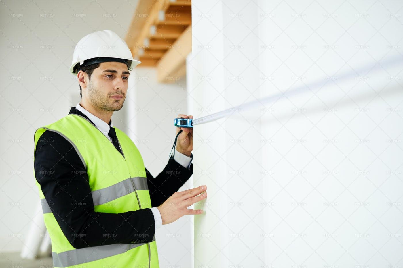 Engineer Measuring Walls: Stock Photos