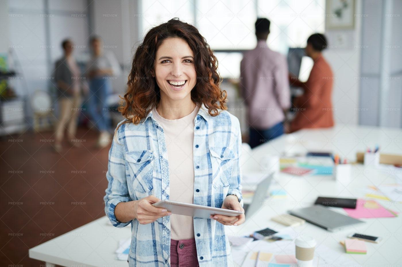 Creative Businesswoman Smiling At...: Stock Photos