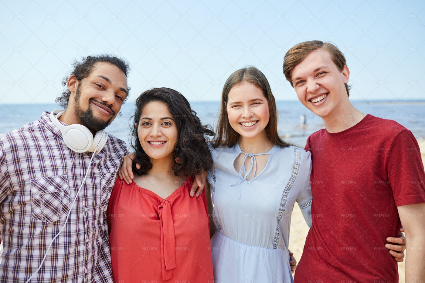 Four Friends Posing By Sea: Stock Photos