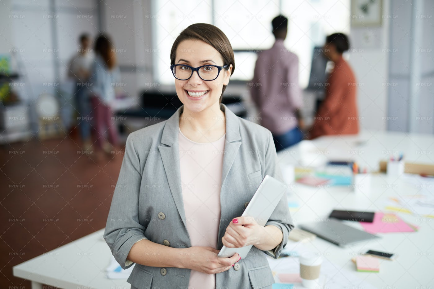 Smiling Businesswoman Standing In...: Stock Photos