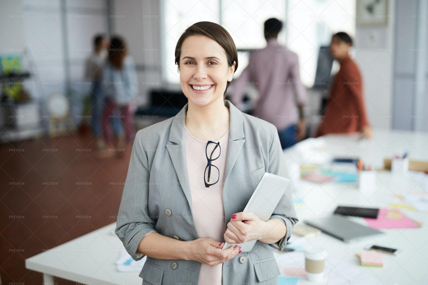 Smiling Businesswoman Posing In...: Stock Photos