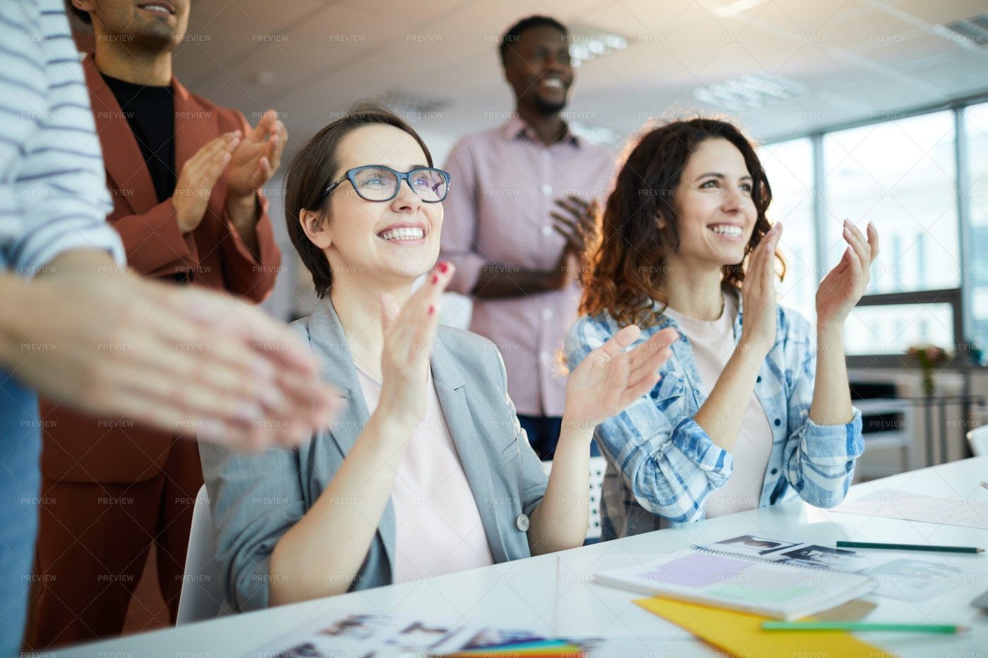 Business People Clapping In Meeting: Stock Photos