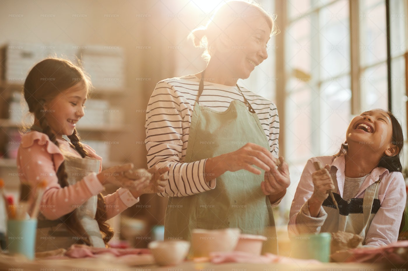 Cute Little Children In Pottery...: Stock Photos