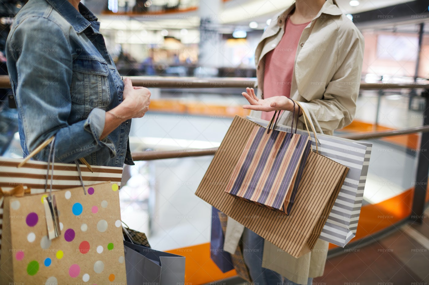 Women Discussing Purchases In...: Stock Photos
