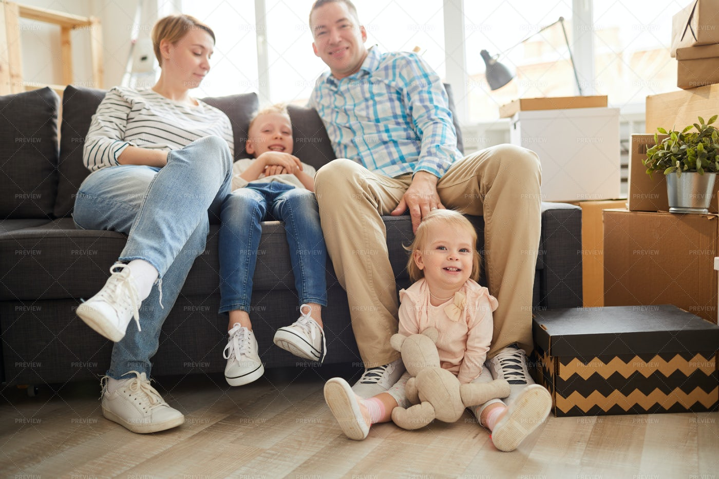 Modern Young Family At Home: Stock Photos