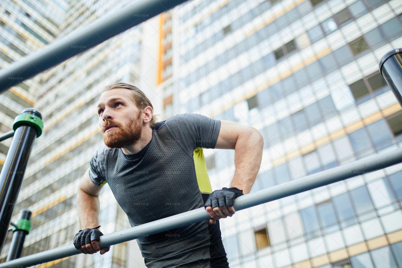 Bearded Man Doing Pull-ups: Stock Photos