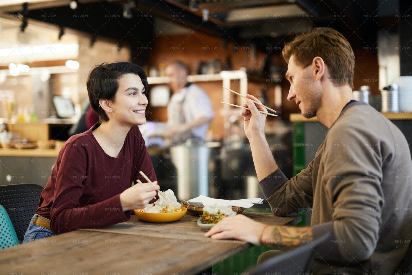 Couple In Chinese Food Restaurant: Stock Photos