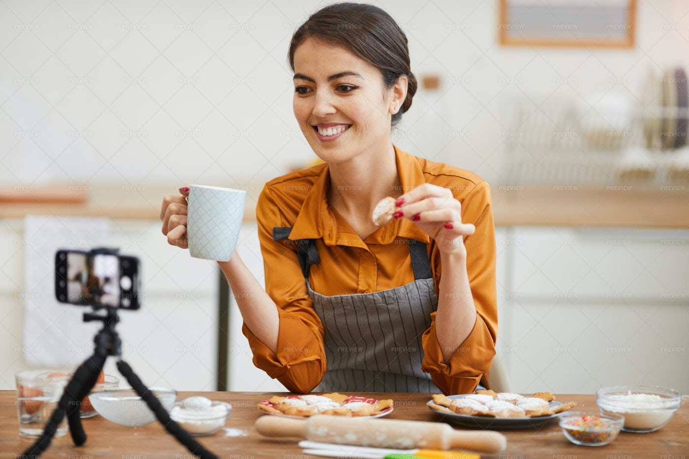 Young Woman Filming In Cozy Kitchen: Stock Photos