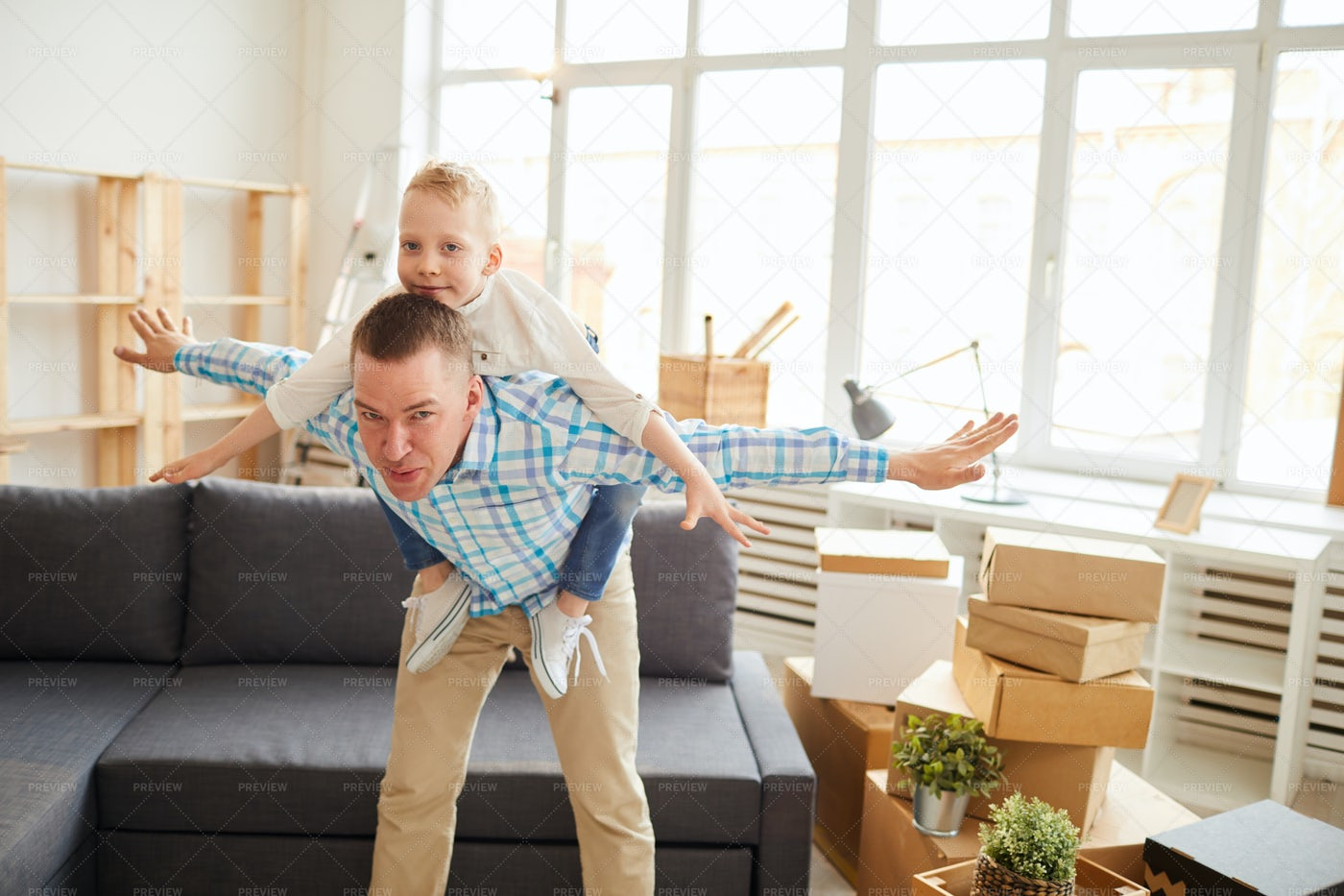 Playing Airplane With Son: Stock Photos