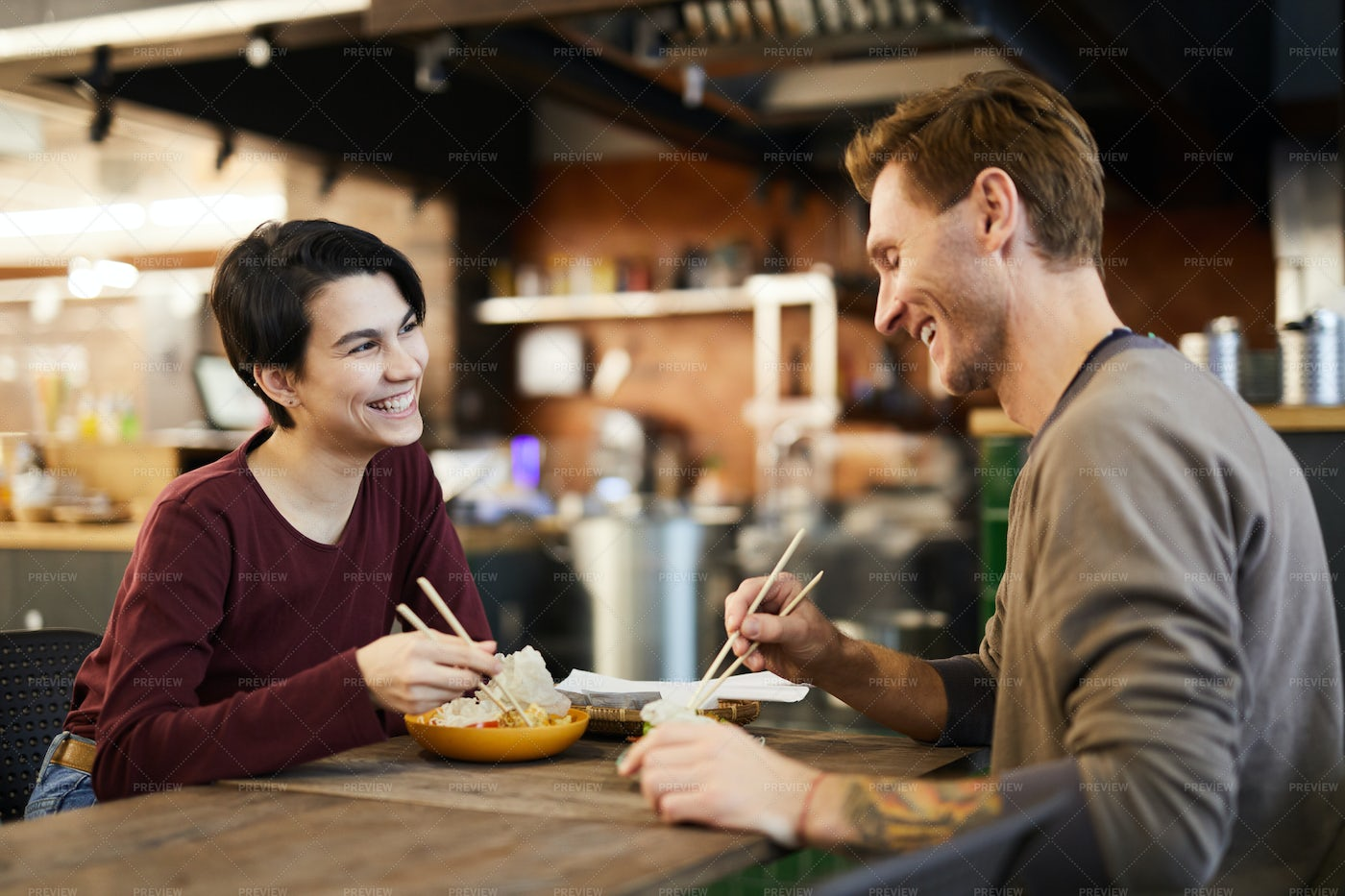 Cheerful Couple In Chinese Food...: Stock Photos