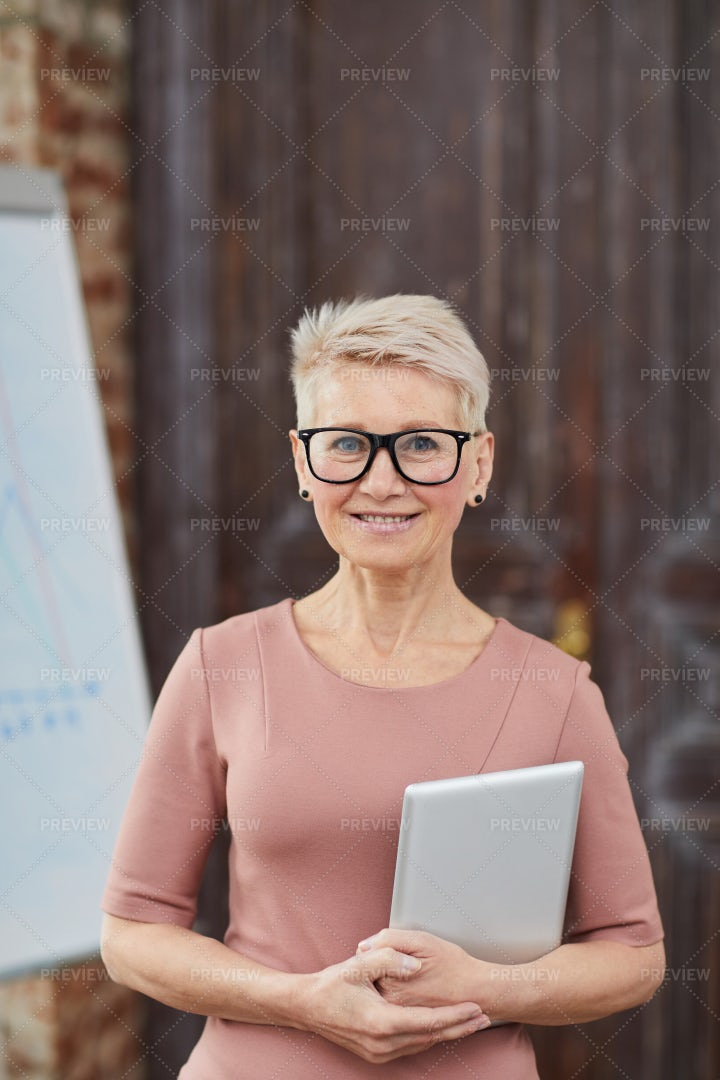 Mature Businesswoman Wearing...: Stock Photos