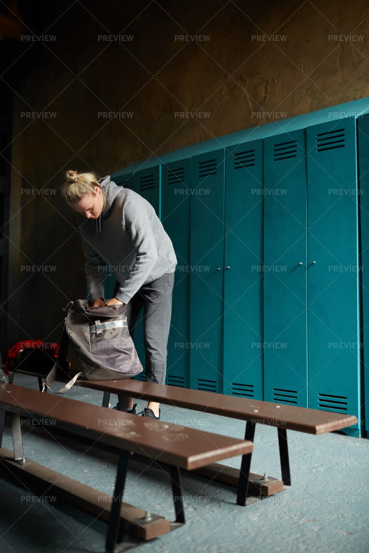 Woman Dressing In Sports Club: Stock Photos
