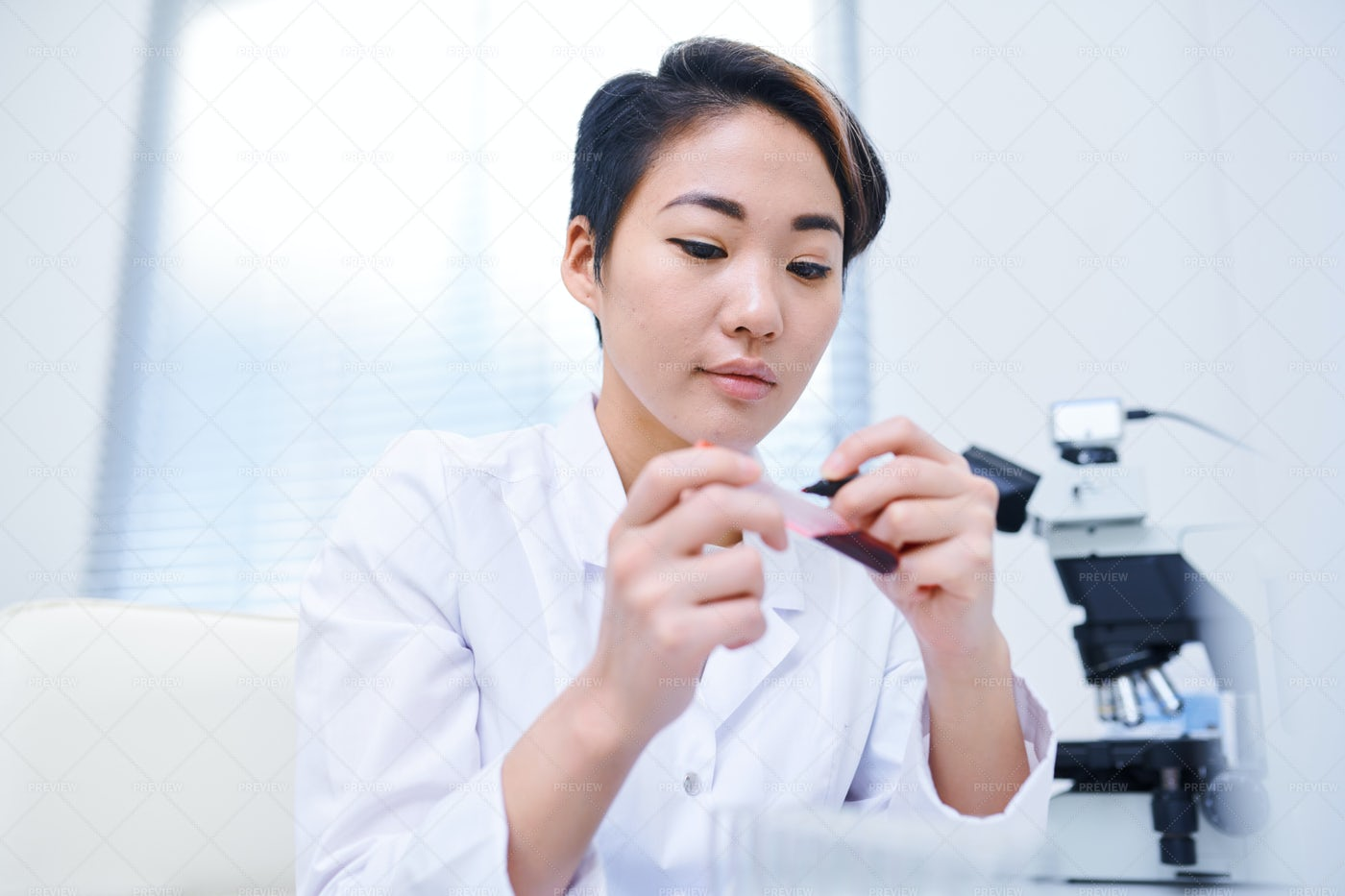 Laboratory Worker Writing On Test...: Stock Photos