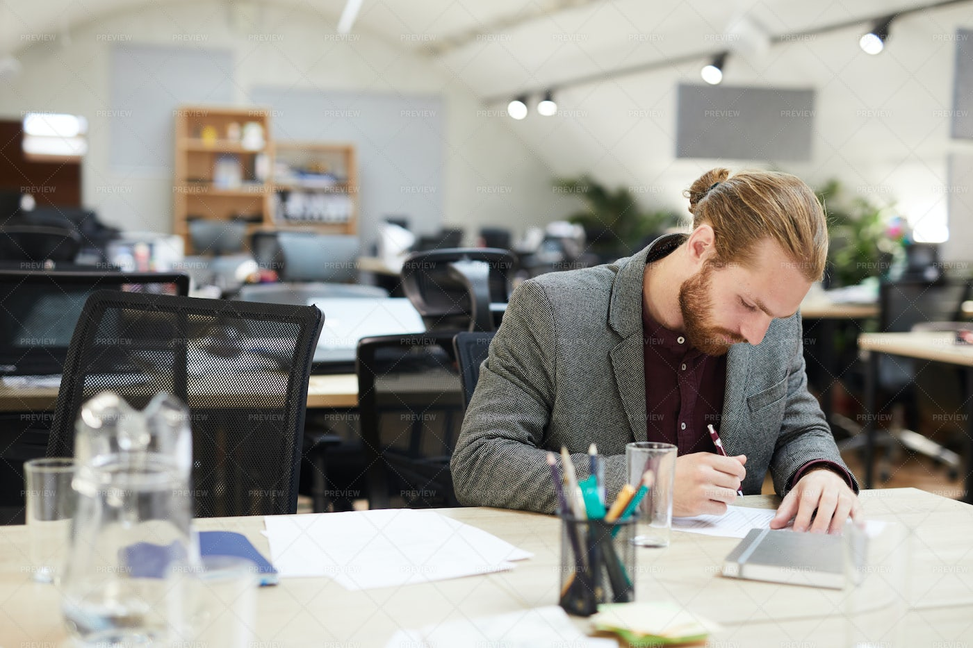 Businessman Working In Open Space...: Stock Photos