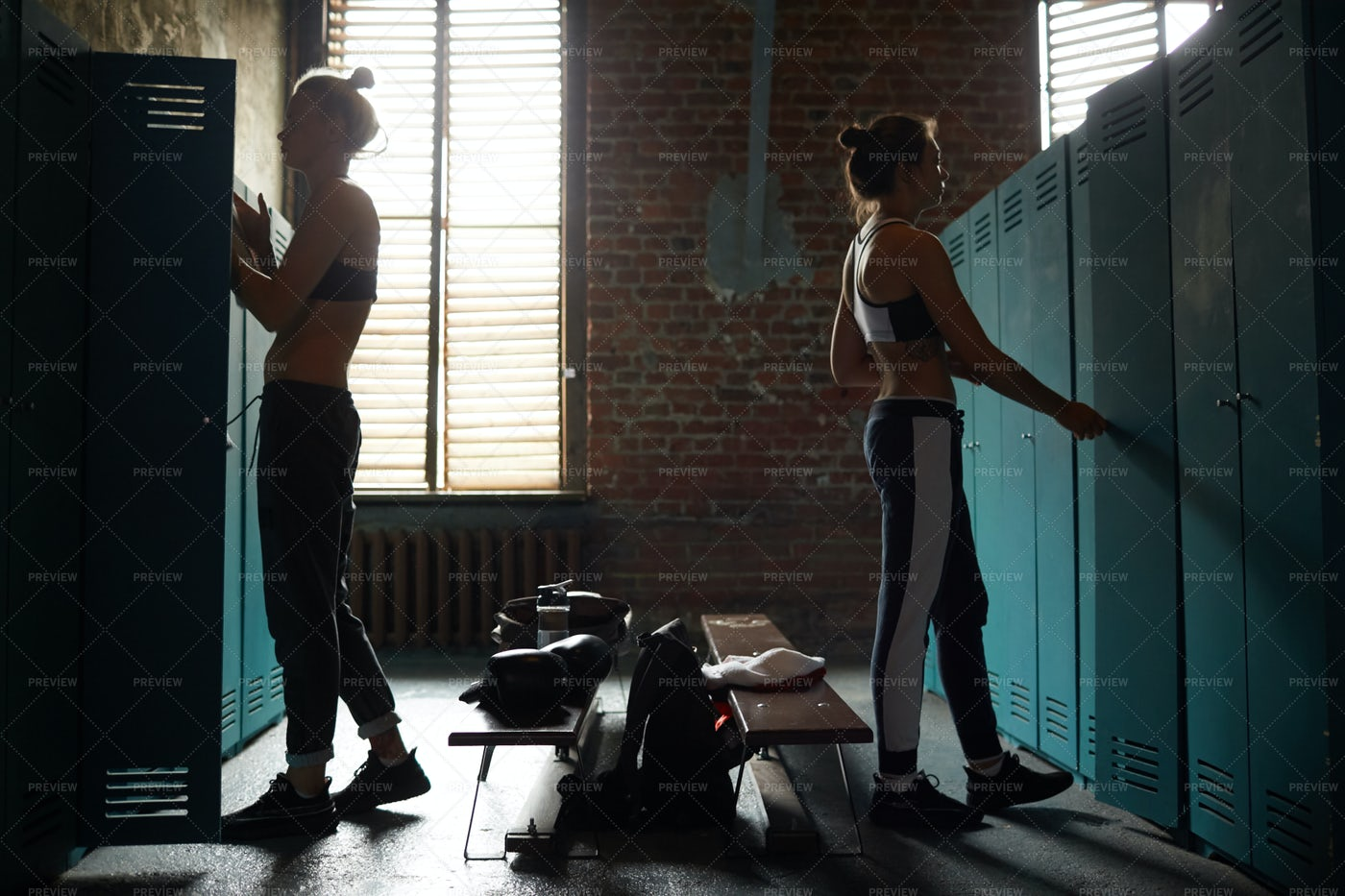 Two Women Dressing In Sports Club: Stock Photos