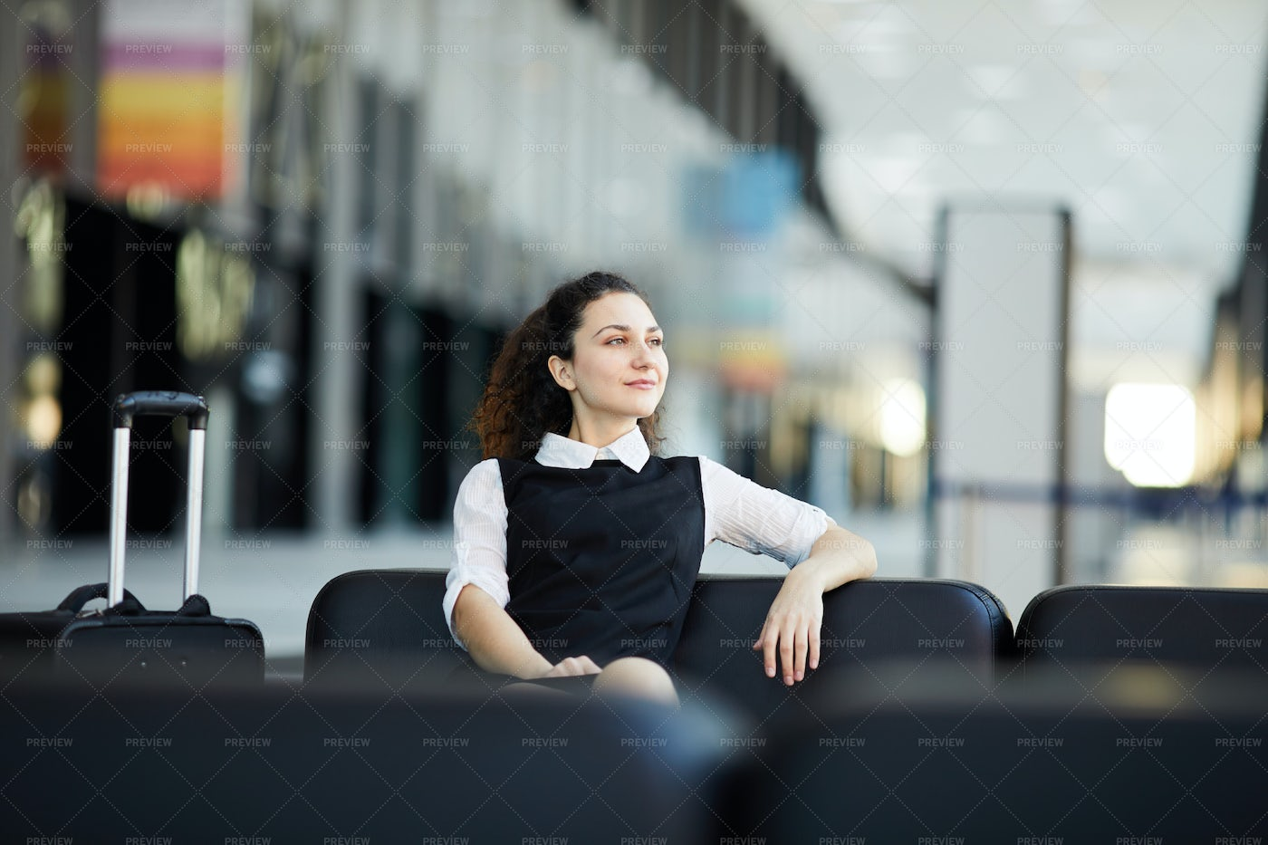Smiling Woman Waiting In Airport: Stock Photos