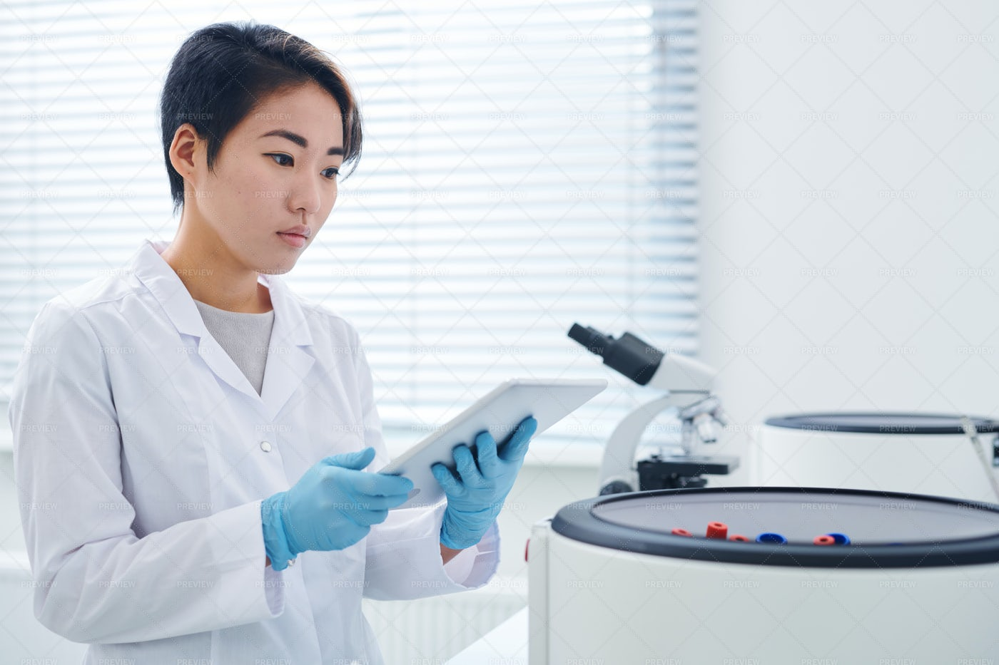 Modern Researcher Viewing Results...: Stock Photos