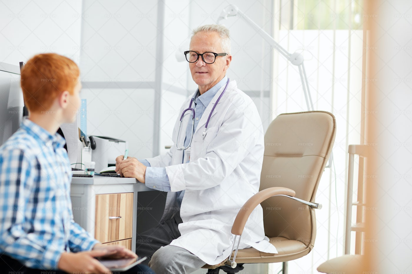 Senior Doctor Talking To Teenage...: Stock Photos