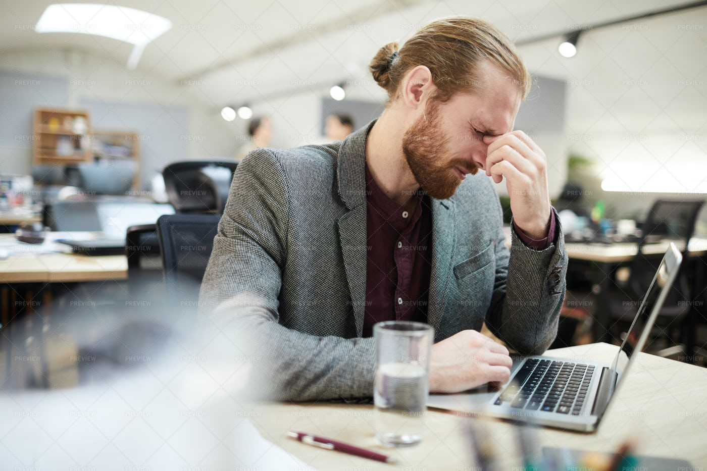 Exhausted Businessman Working In...: Stock Photos