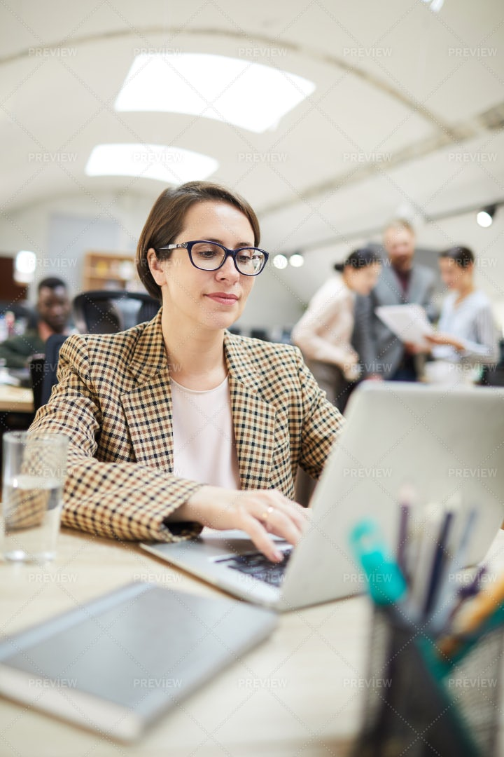 Businesswoman Working In Open Space...: Stock Photos