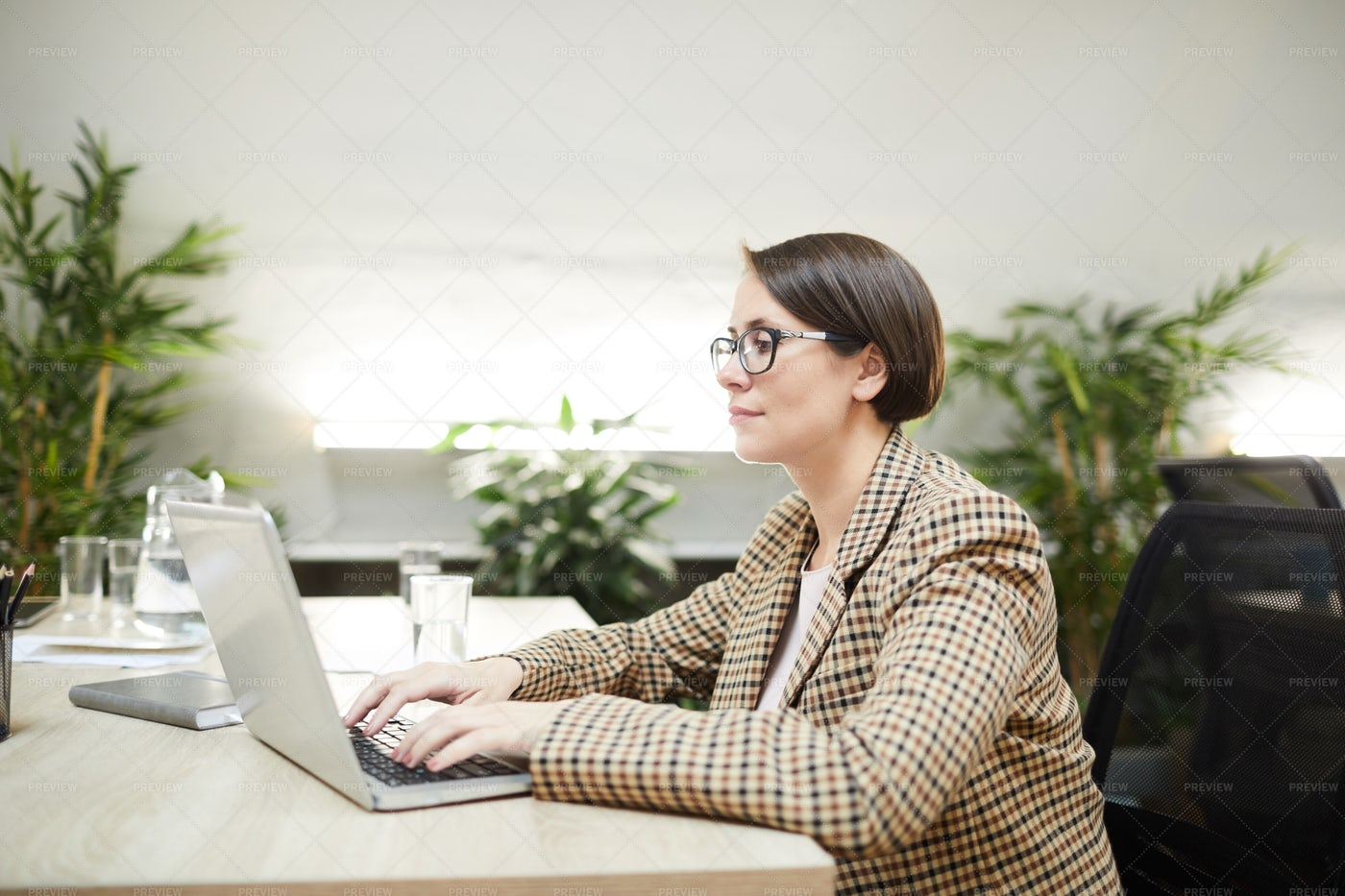 Contemporary Businesswoman Working...: Stock Photos