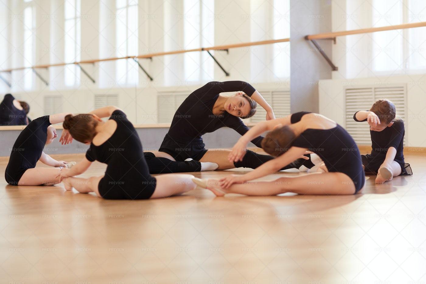Girls  Stretching In Dance Studio: Stock Photos