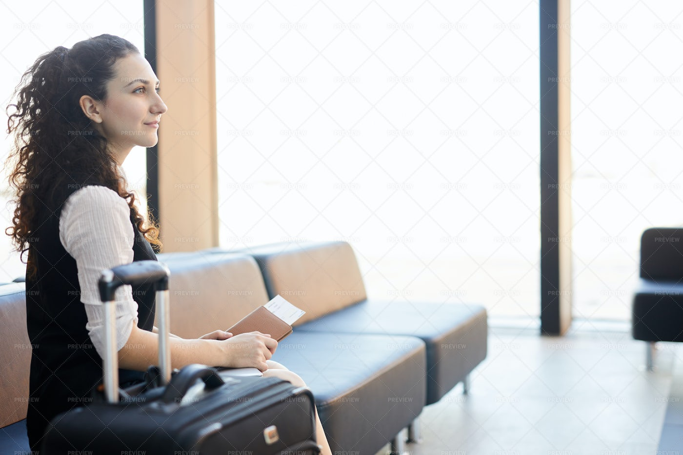 Inspired Traveller In Airport: Stock Photos