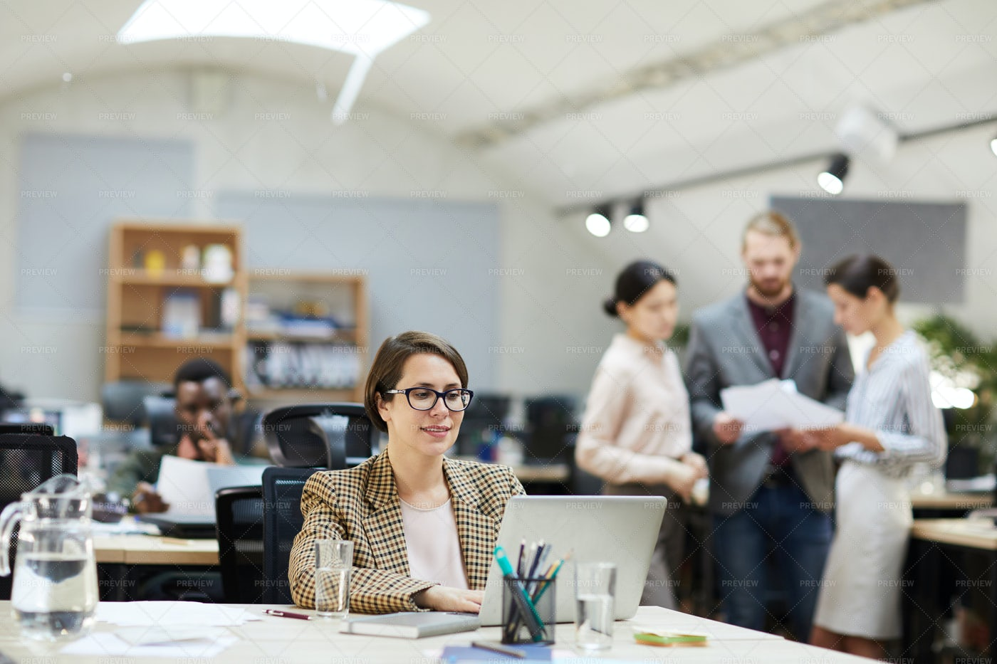 Smiling Businesswoman Working In...: Stock Photos