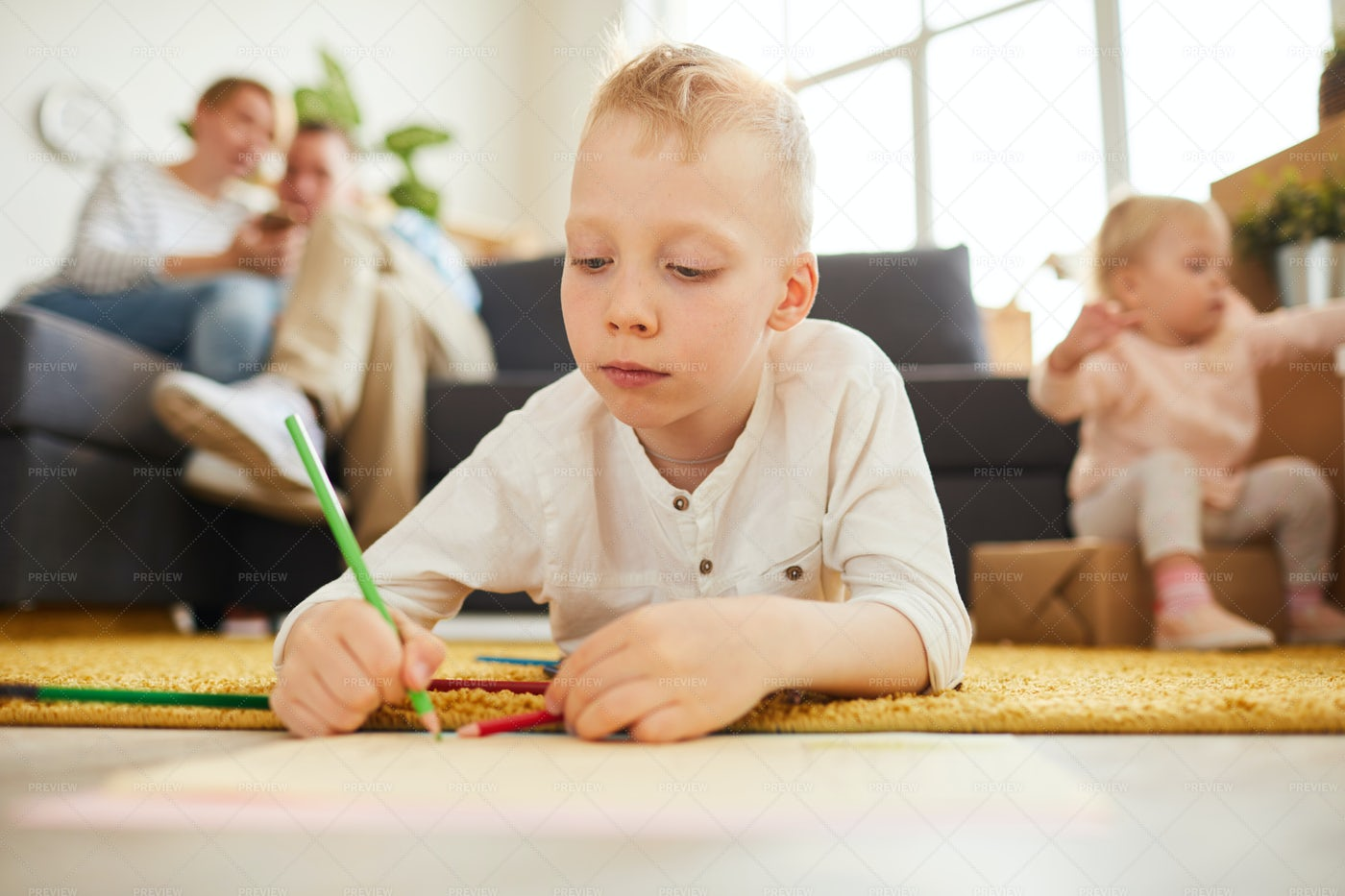 Boy Concentrated On Drawing: Stock Photos