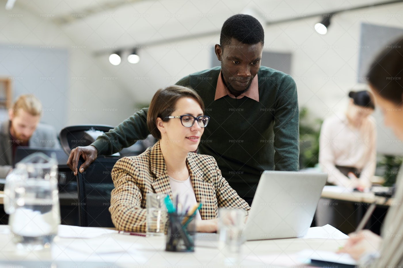 Female Business Manager Working In...: Stock Photos